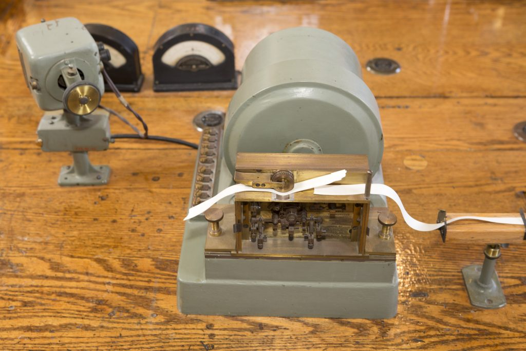 A ticker tape machine at Heart's Content Cable Station in Newfoundland and Labrador, Canada. In 1866 Heart's Content was connected to Valentia Island, Ireland, with a submarine, transatlantic telepgraph cable.