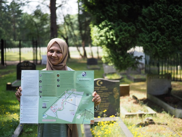Woman holding map of British Muslim Heritage Trail
