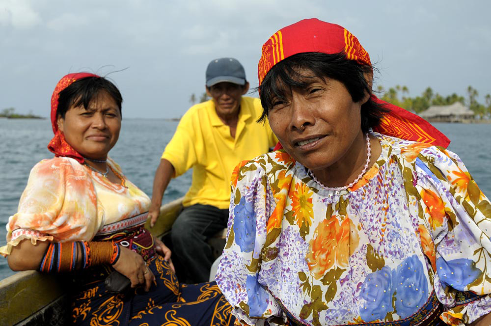 Indigenous Kuna people in a boat off Panama's San Blas islands by Jeremy Hoare.