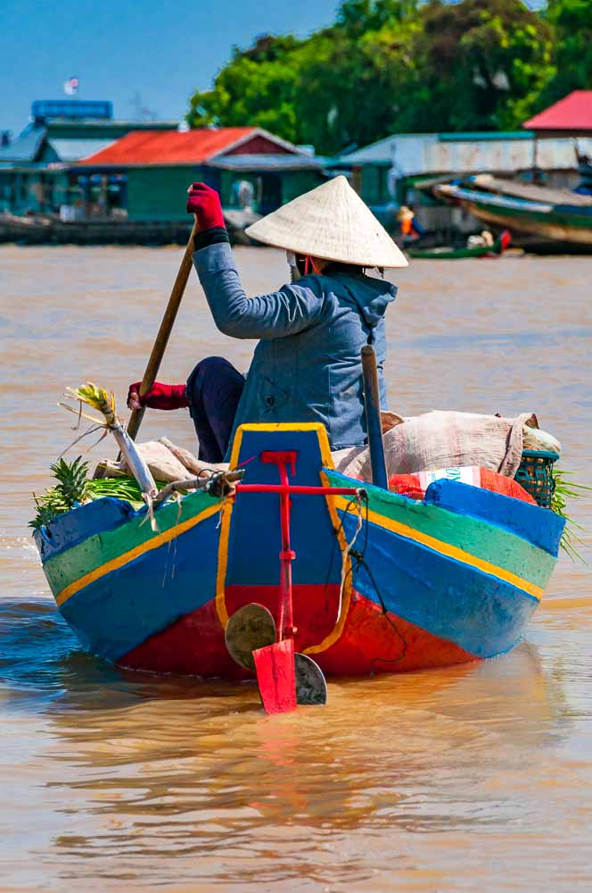Mark Andrews photographed a woman rowing a boat at Chong Kneas, Tonle Sap Lake, Cambodia