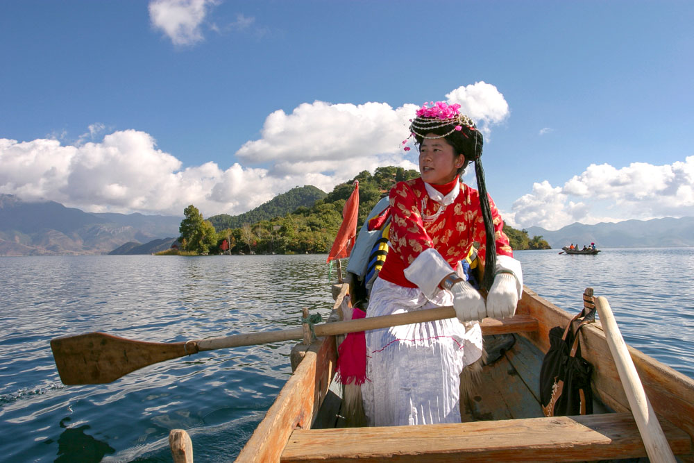 Peter Ellegard photographed a woman rowing on Lugu Lake bordering the Yunnan and Sichuan provinces in China