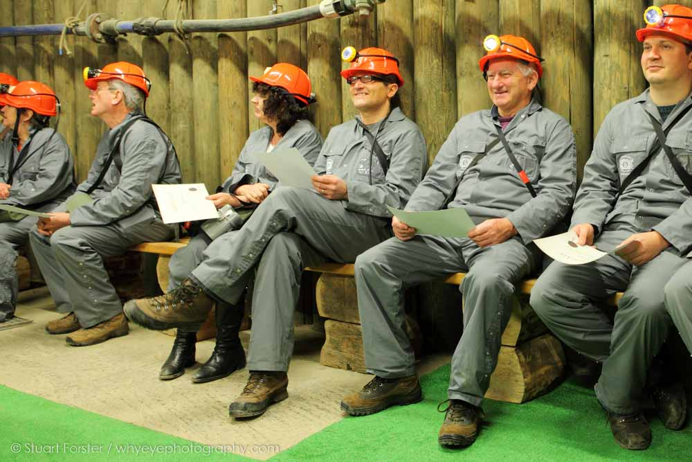 Guild members dressed in overalls and safety helmets to enter Wieliczka Salt Mine near Krakow in Poland