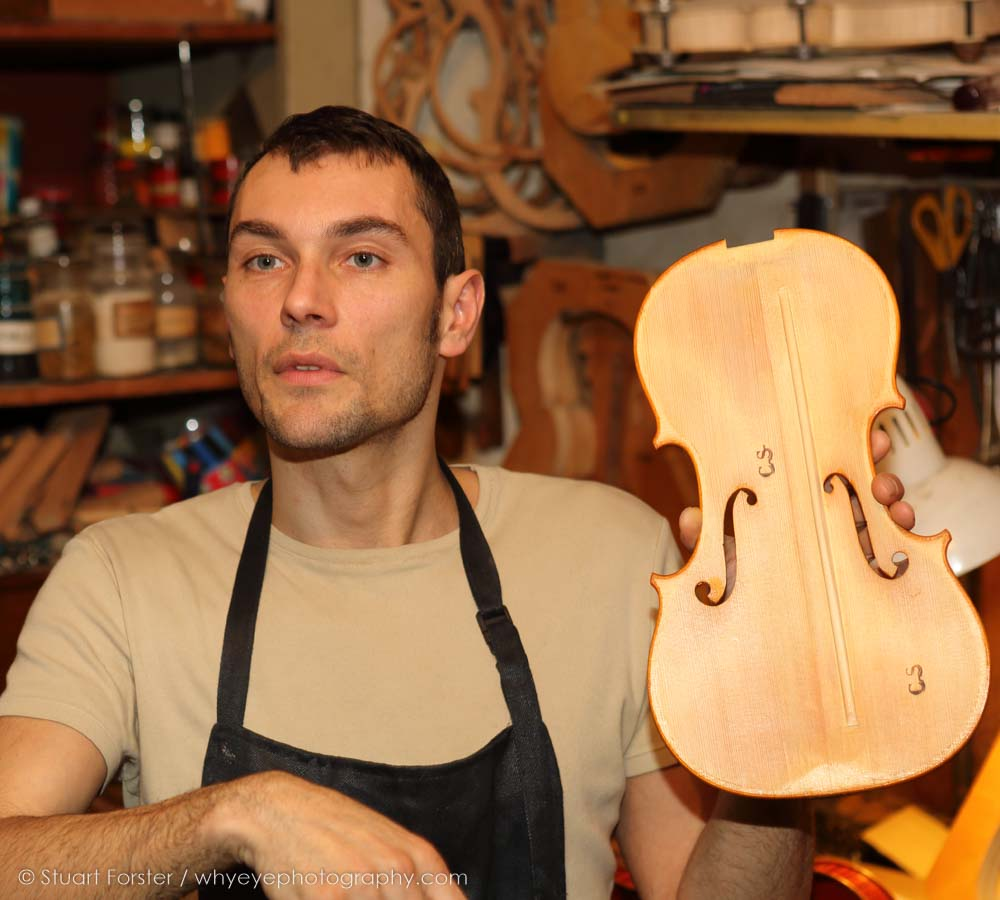 A violin maker in Cremona explains his craft during a familiarisation trip after the 2015 AGM in Milan, Italy