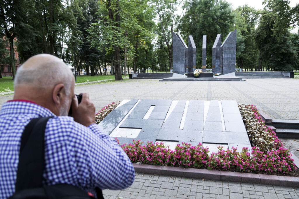 Geoff Moore photographs a war memorial in Daugavpils during the Guild press trip to Latvia