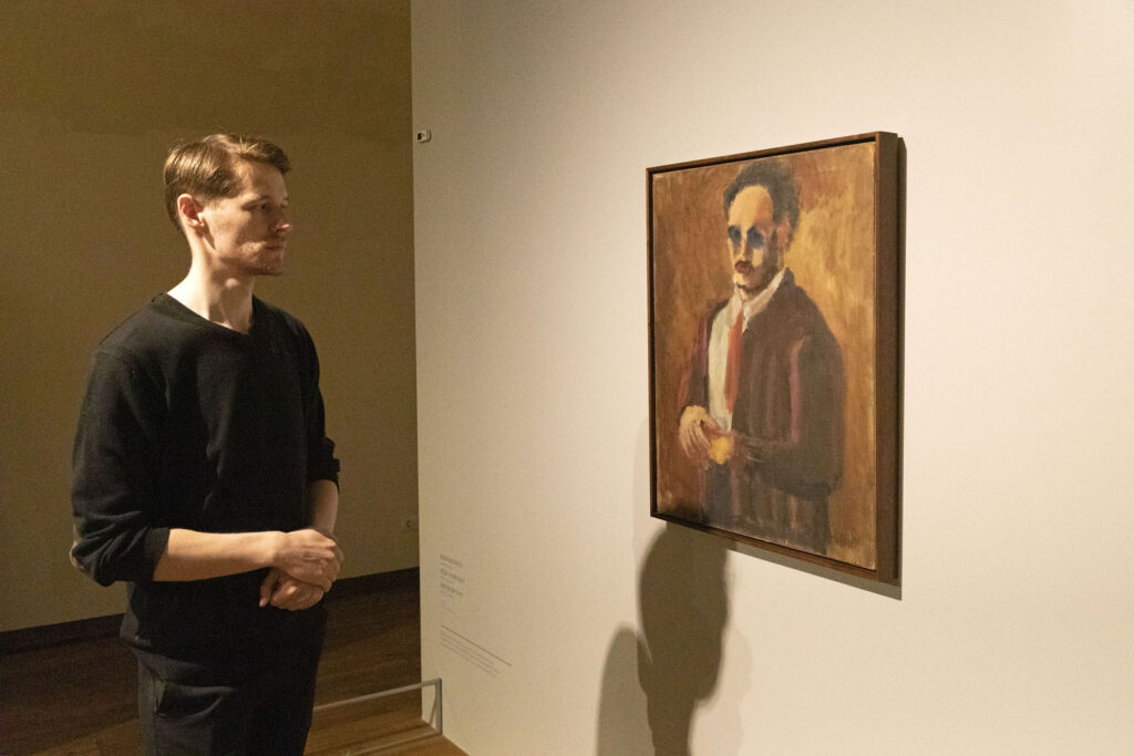 A man looks at a self-portrait of artist Mark Rothko displayed at the Mark Rothko Art Centre in Daugavpils.