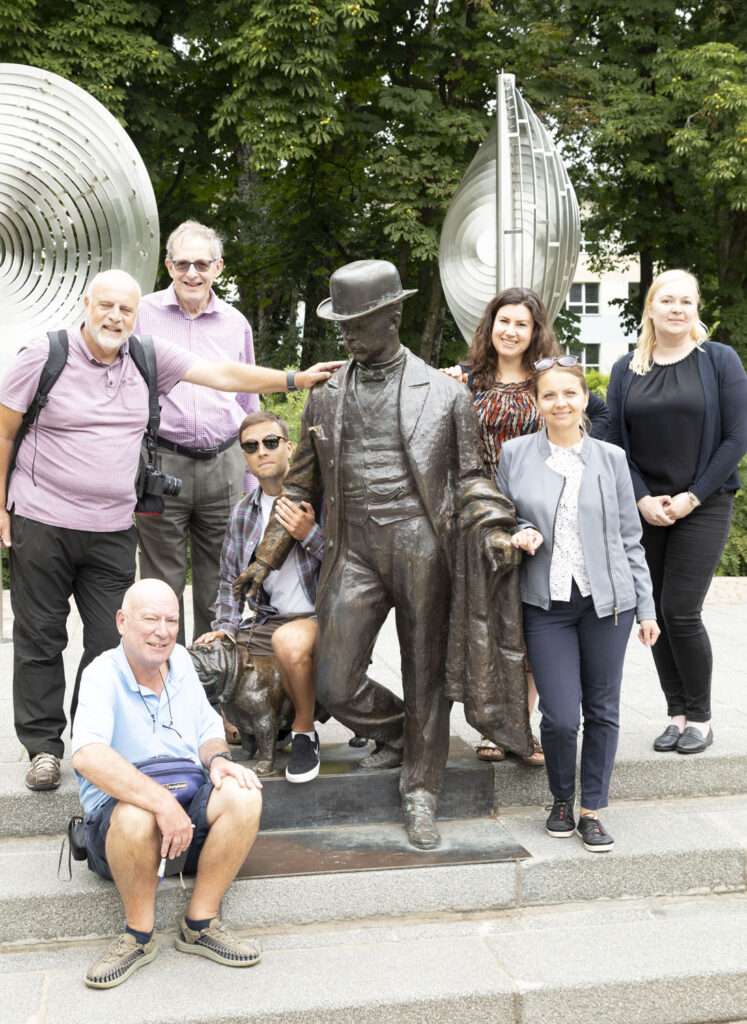Members of the British Guild of Travel Writers with a statue of Daugavpils' former mayor Pavel Dubrovin