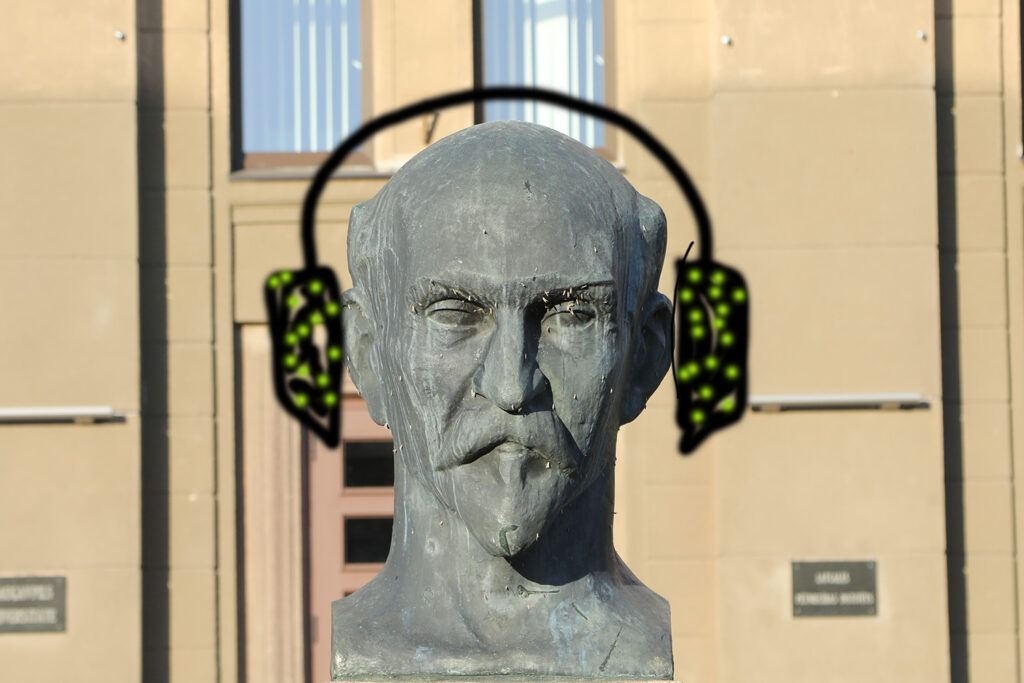 Statue with graffiti headphones.