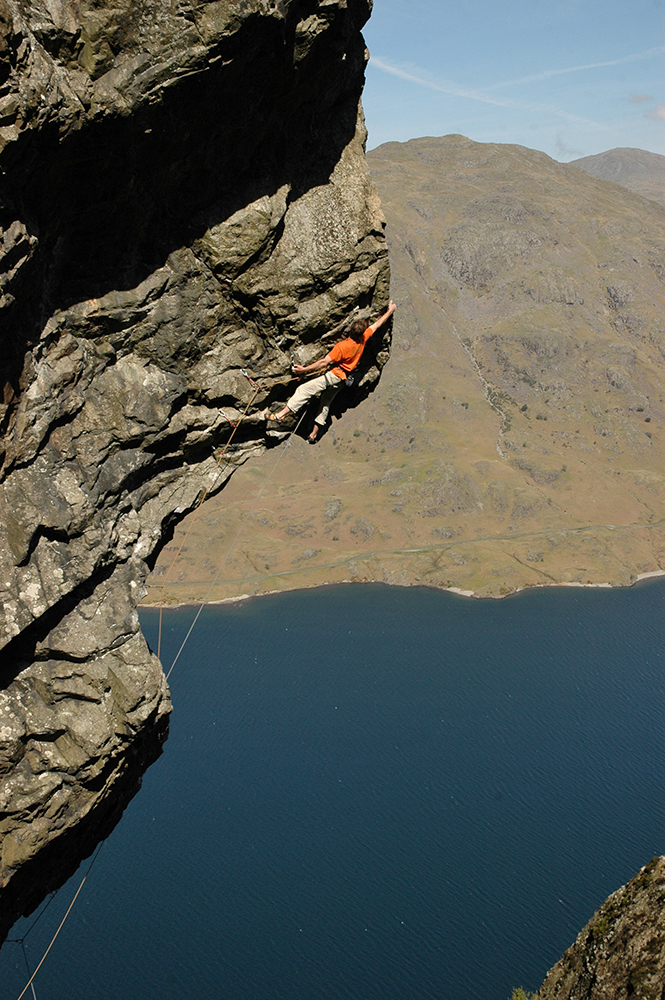 Dave Birkett making the first ascent of a route called 'Nowt But A Fleein Thing' on Cam Crag, Wasdale by Bill Birkett