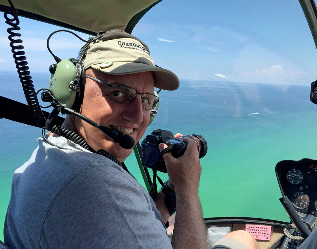 Photographer Peter Ellegard in a helicopter over Panama City Beach Florida