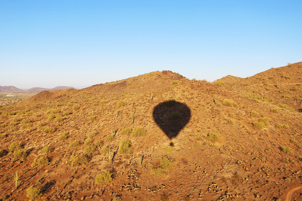 Lynne Coates shadow of a hot air balloon in one of the USA's open spaces.