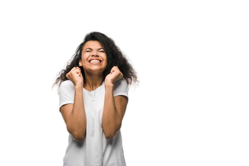 Happy woman celebrating a small win