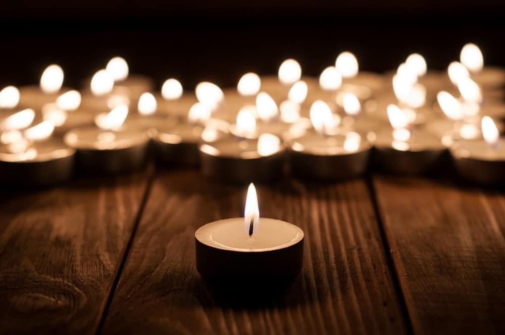 Group of burning candles on black background. Focus meditation