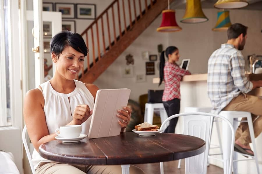 Woman in a cafe with a tablet