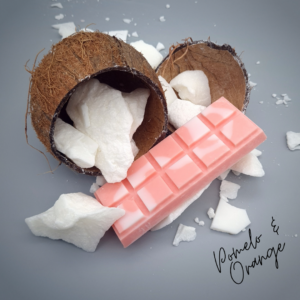 Pink Wax Melt Snap Bar surrounded by white coconut wax falling from a coconut shell on a grey background