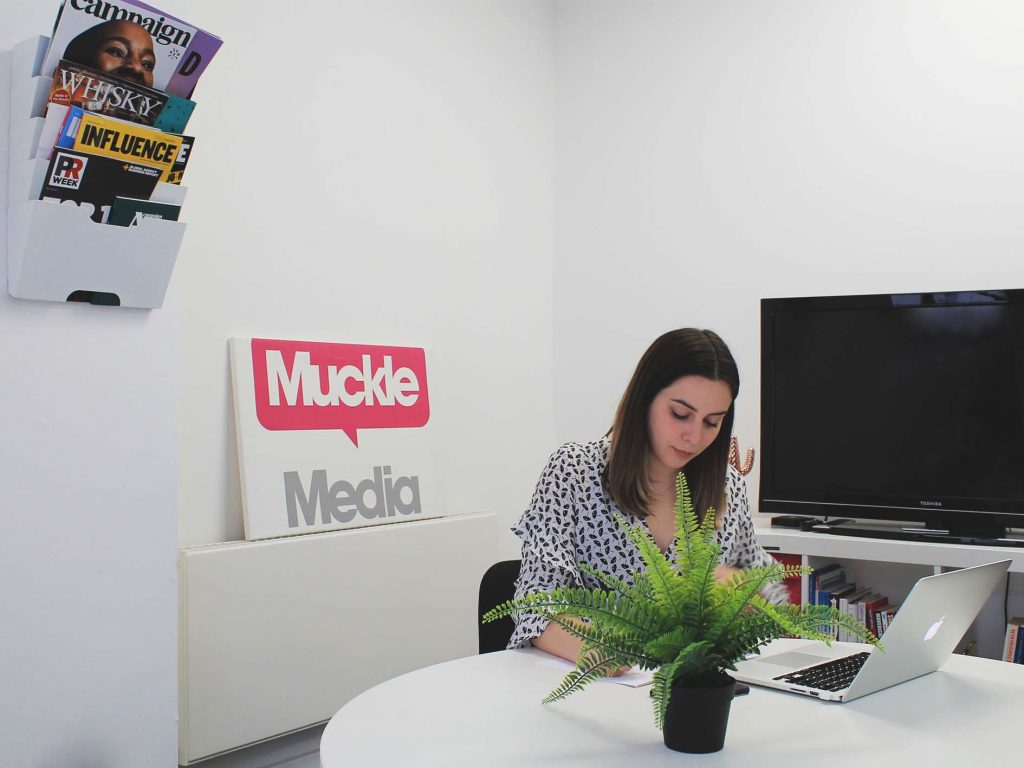 Intern, Emily in the Muckle Media board room