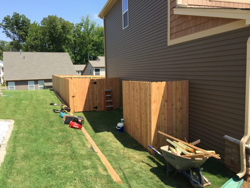 Wood fence installation in Waxhaw