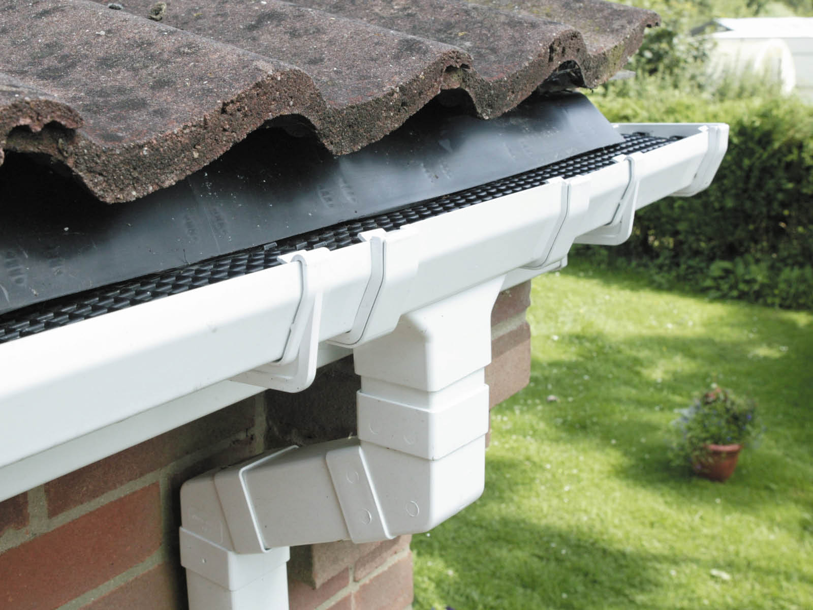 white bevelled guttering with vermin and leaf control