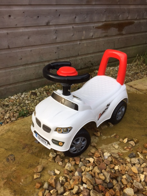 white BMW ride on toy with red push-along handle