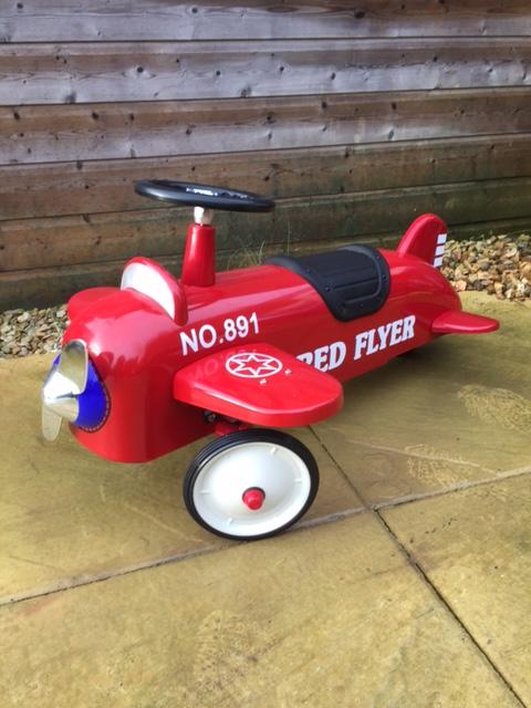 Retro red aeroplane ride on toy