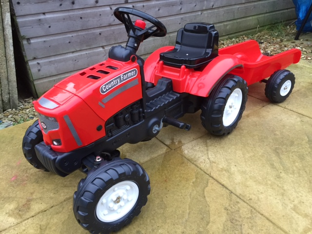 Red country farmer tractor ride on toy, with trailer