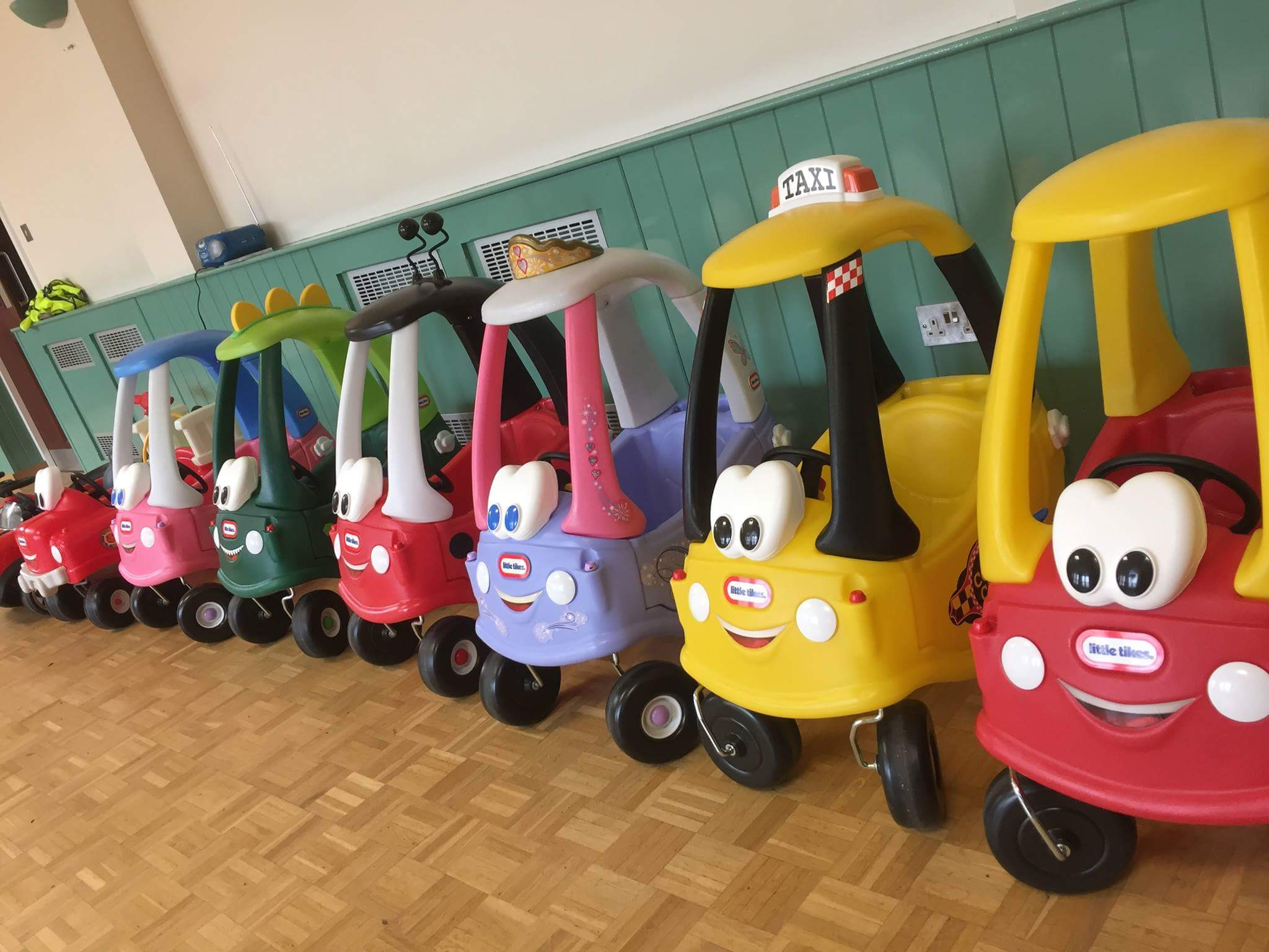 a collection of Little Tikes ride on toys