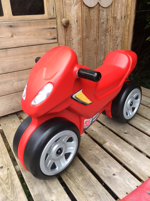 Red motorbike ride on toy