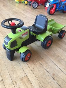 Small green Klass tractor ride on toy with trailer