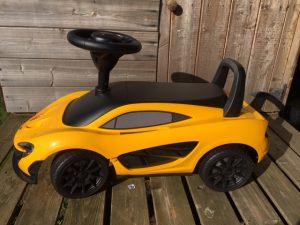 yellow Maclaren ride on toy