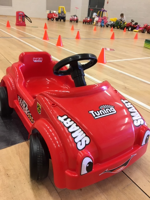 Red pedal car