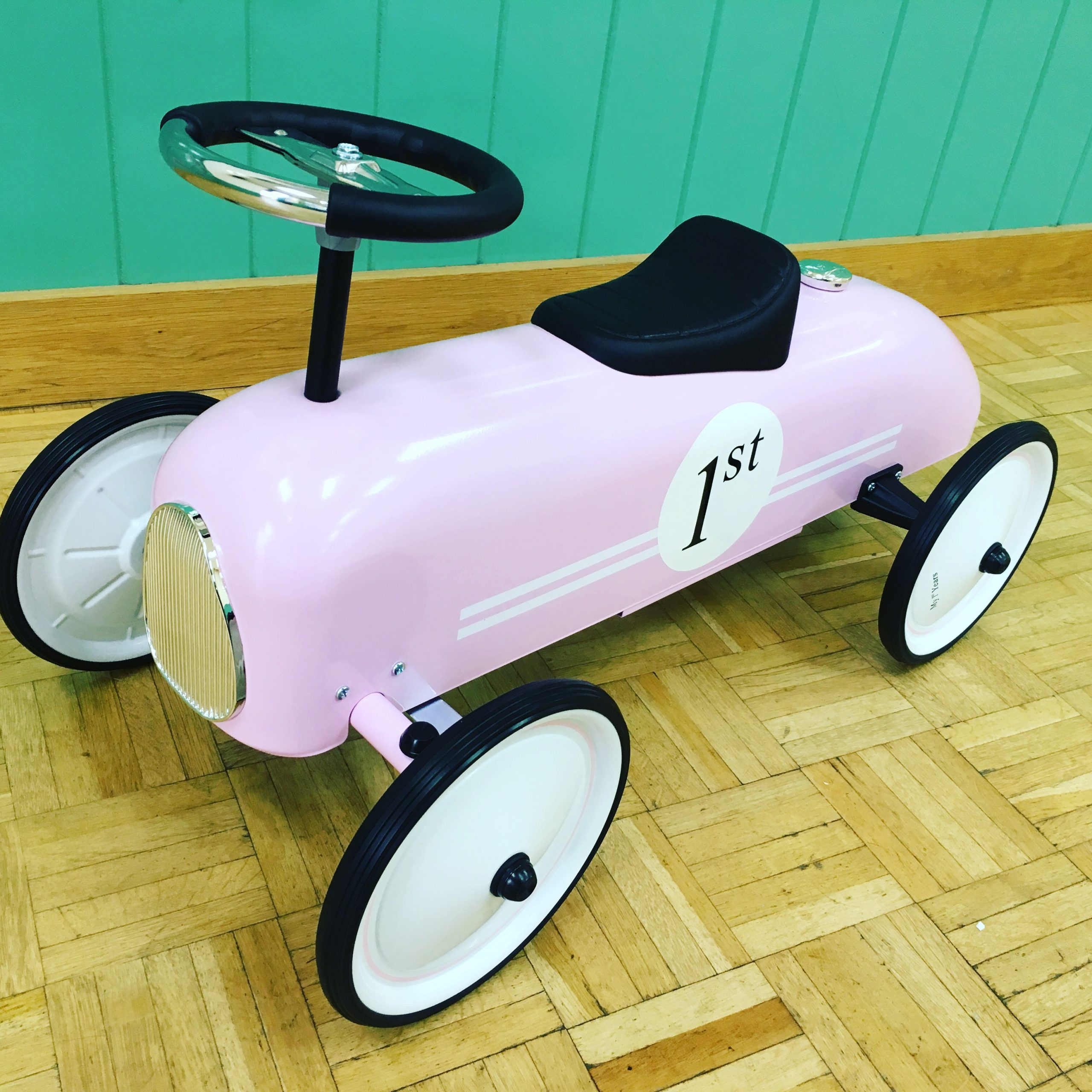 Retro racing car pink ride on toy