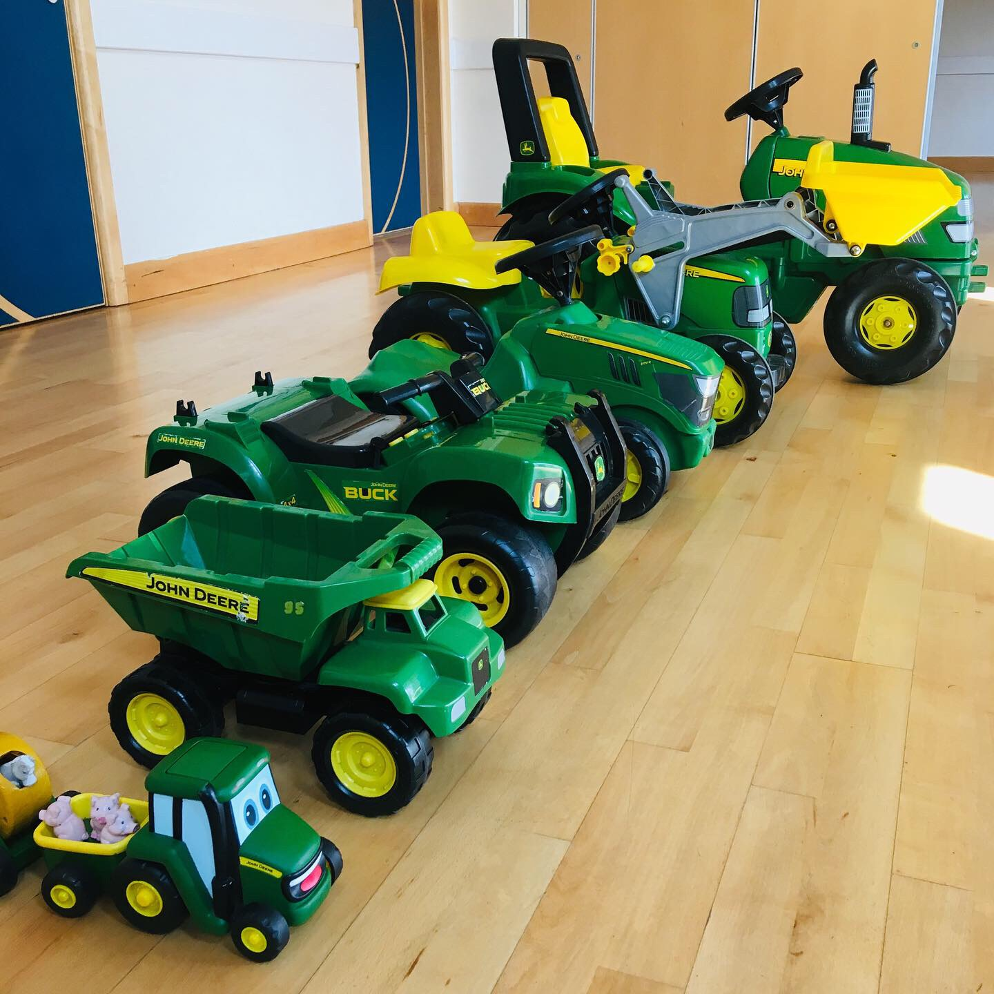 a collection of tractors and farm vehicles, all in green