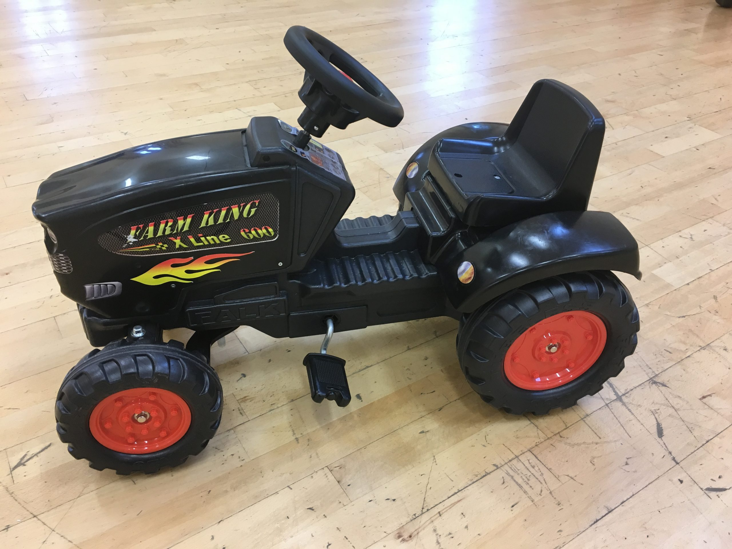 Black tractor ride on toy with Farm King logo