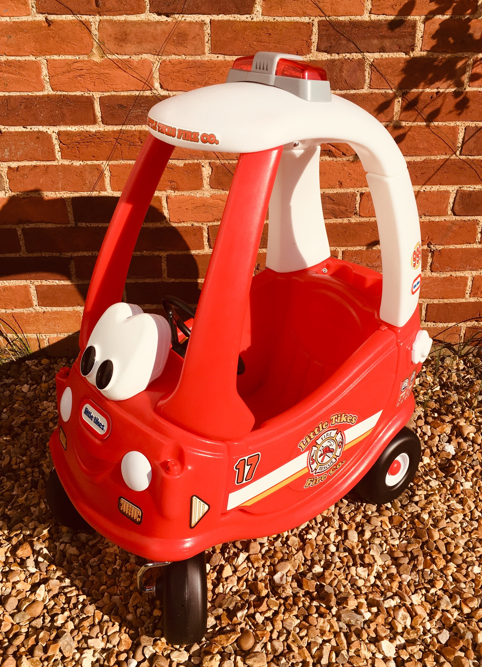 Red and white Little Tikes Fire Engine cozy coupe ride on toy