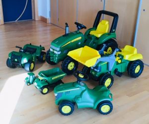a collection of john deere farm vehicles