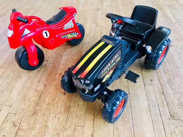 red motorbike and black farm king tractor ride on toys
