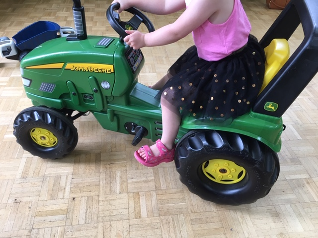 Large green John Deere tractor ride on toy