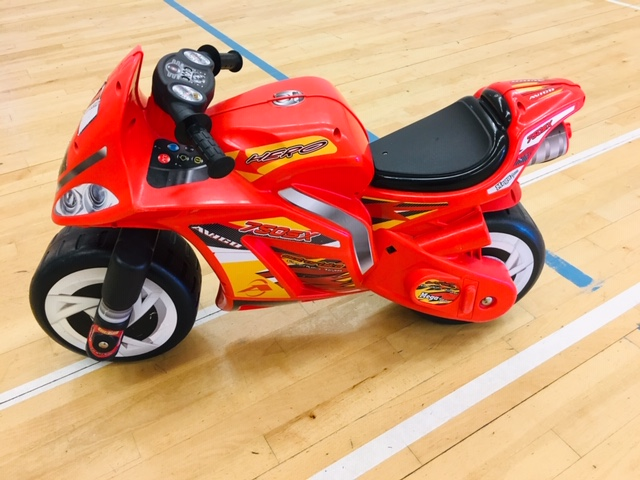 Large red racing motorbike ride on toy