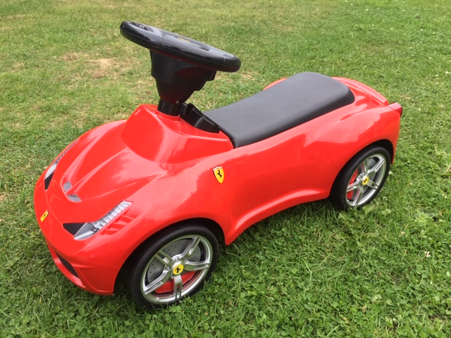 red Ferrari ride on toy