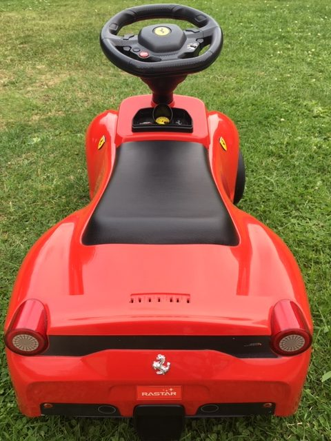 red Ferrari ride on toy