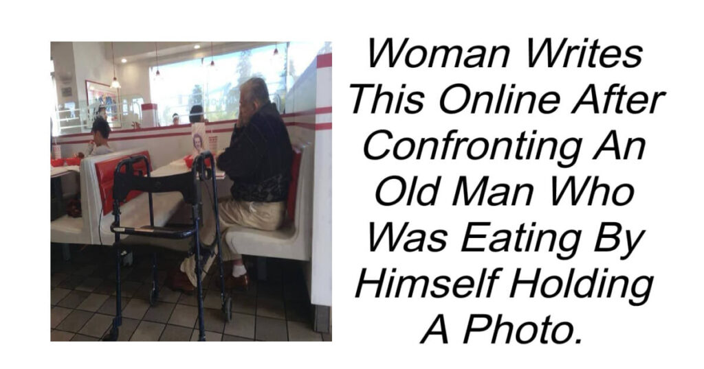 An Old Man Was Eating Alone Holding a Photo.