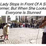 Old Lady Stops In Front Of A Street Performer.