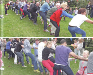 a group of people playing tug of war