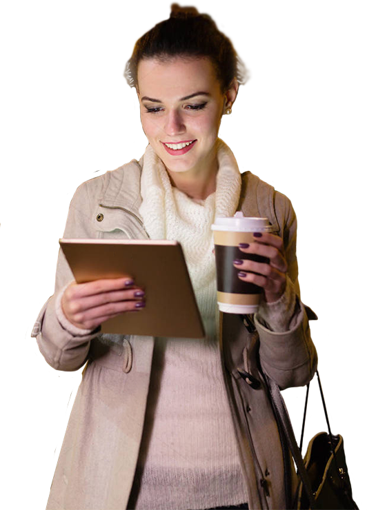 Young Woman holding tablet in right hand and coffee in left hand. Looking into tablet display.