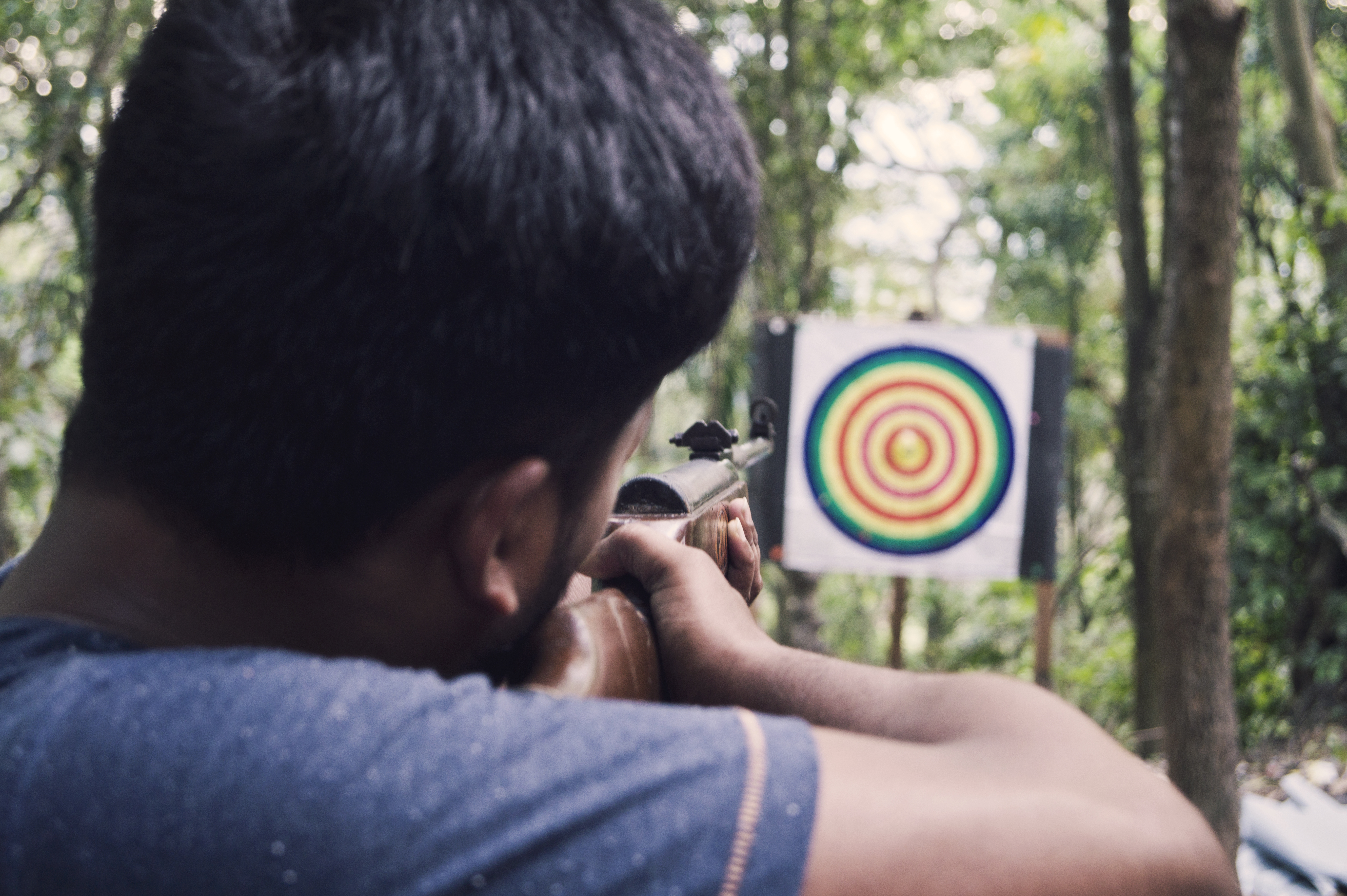 Young Man Aims For The Bull's Eye