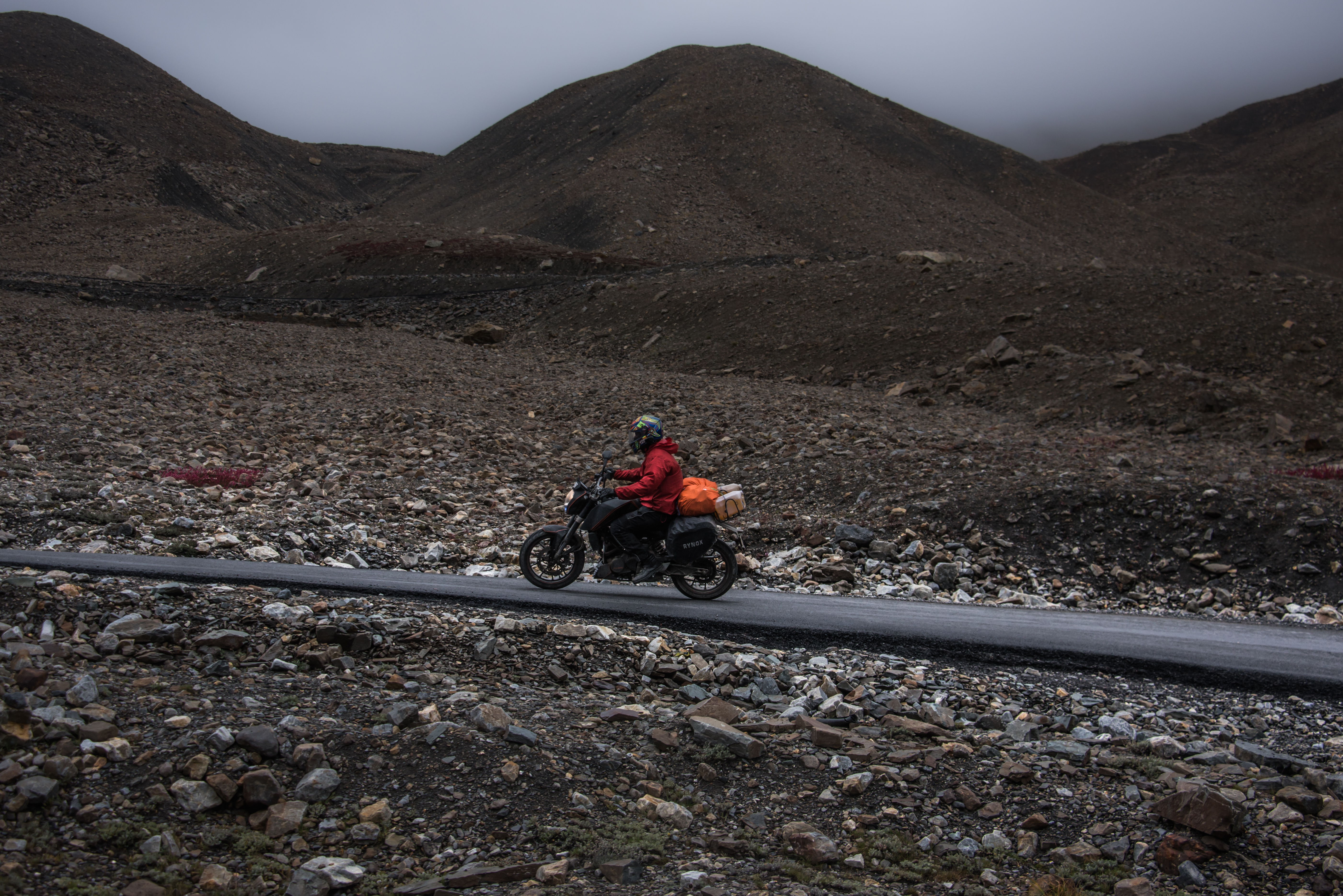 Dude Riding KTM Duke On An Inclined Himalayan Road
