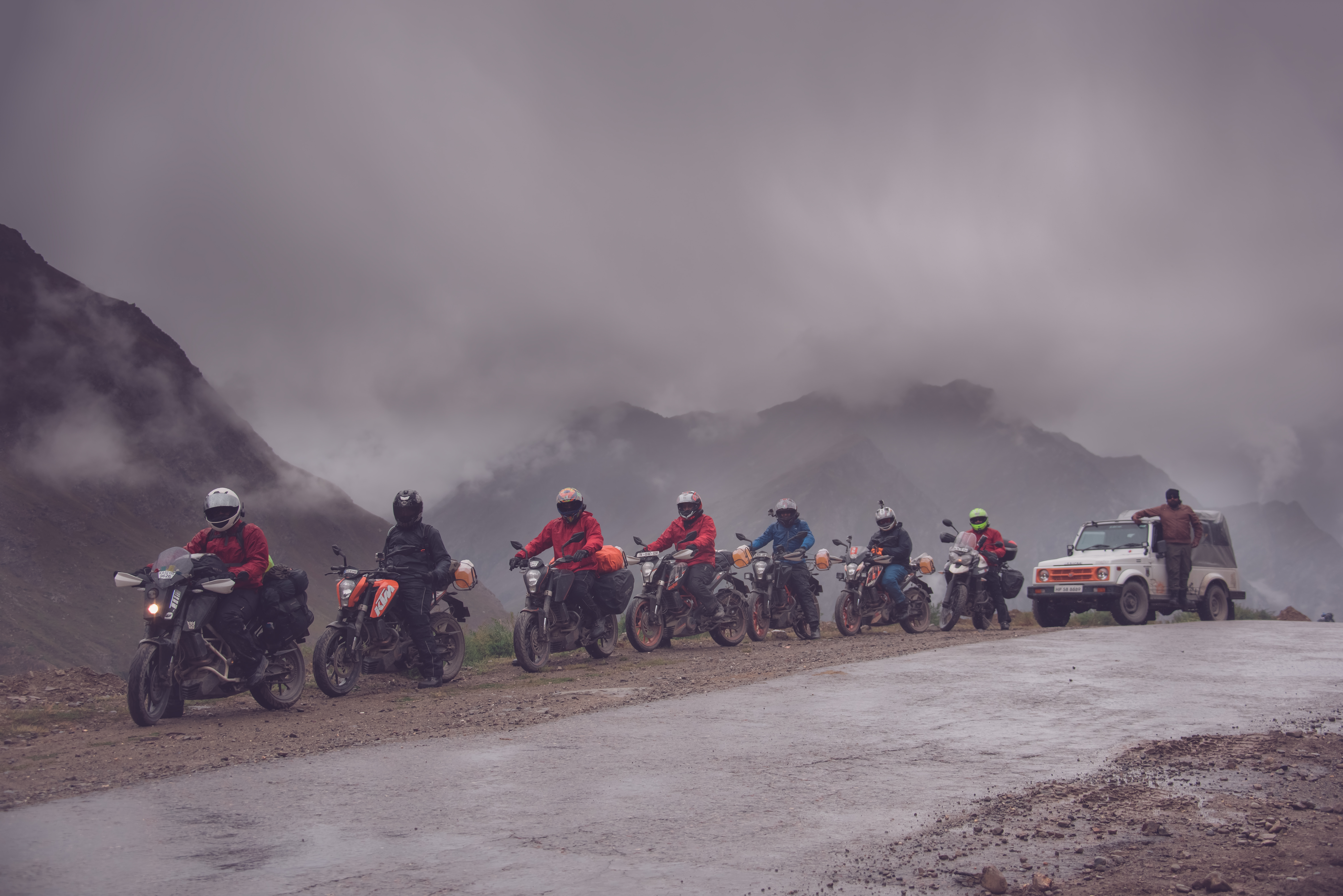 Group Of Friends Riding Through The Himalayas