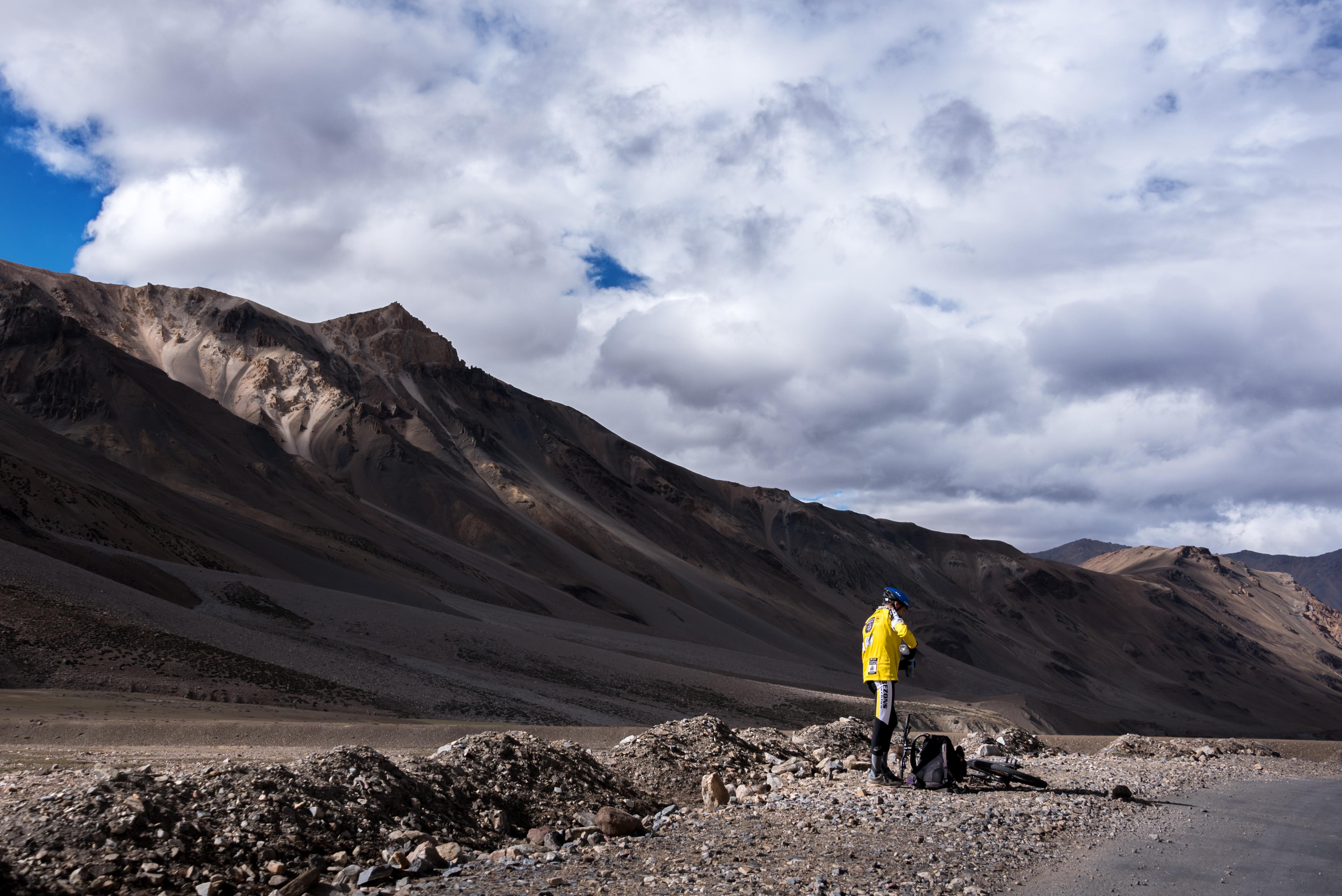 Mountain Biker Takes A Refreshing Break