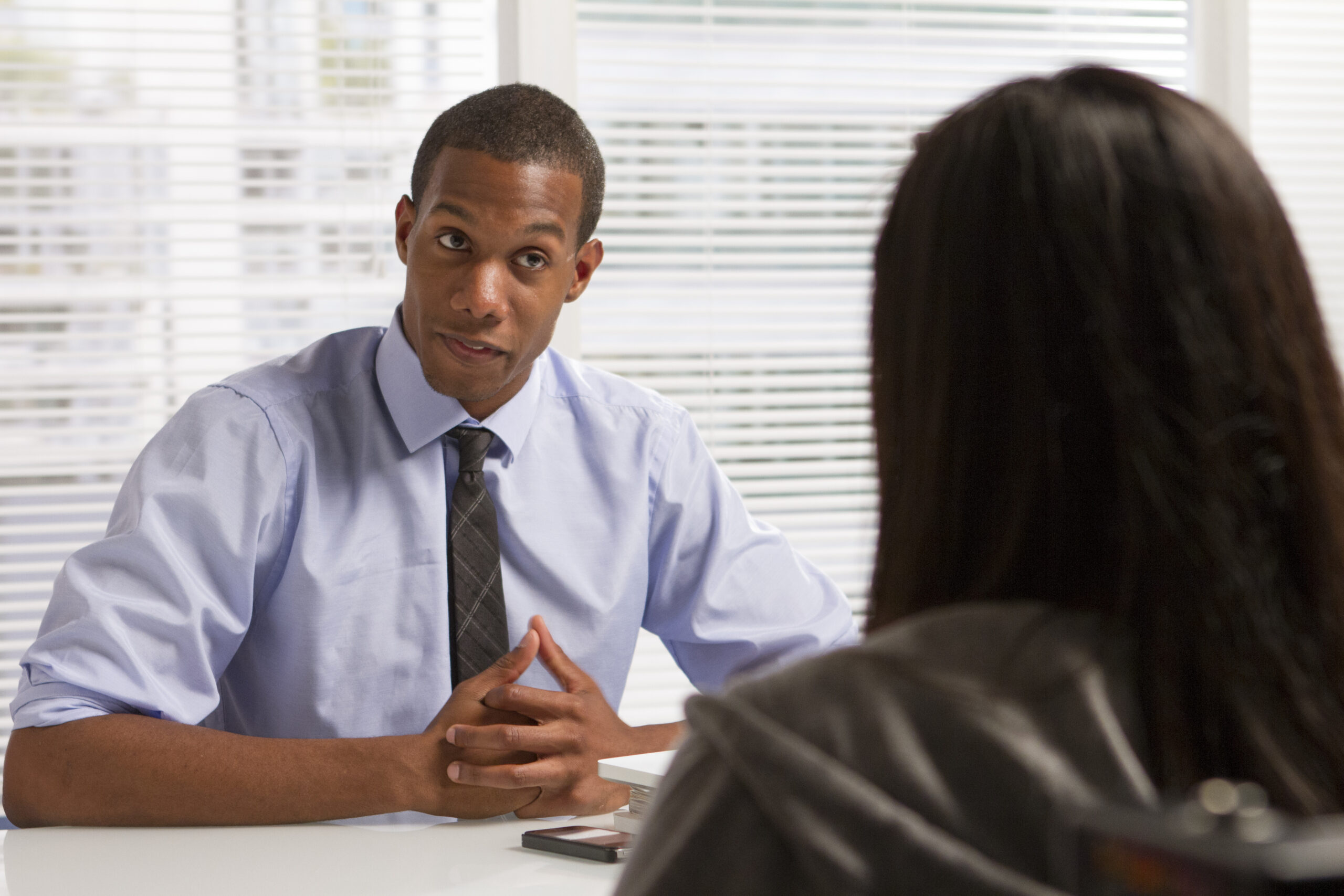 African American businessman with client or colleague