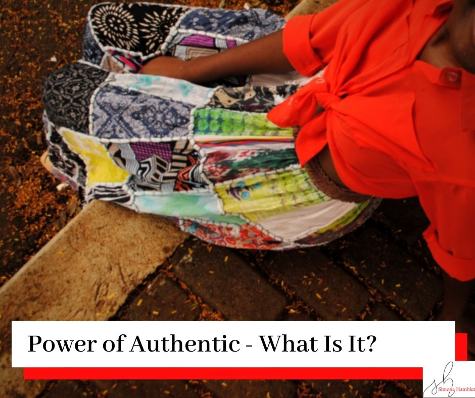 Woman in a skirt and red blouse sat down and looking up with the title Power of Authentic