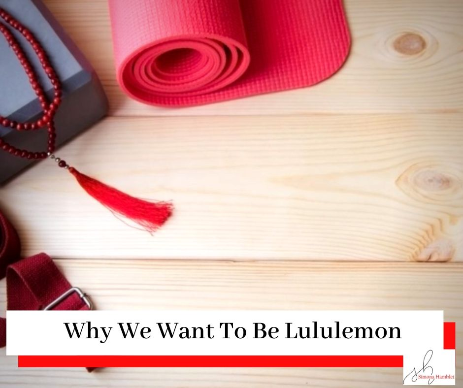 Yoga mat and block on a wooden floor with a title Why We Want To Be lululemon
